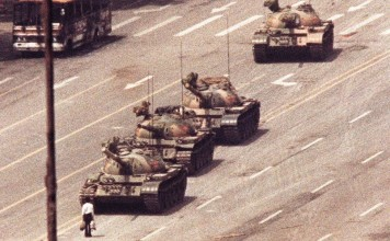 File photo of a man standing in front of a convoy of tanks in the Avenue of Eternal Peace in Tiananmen Square in Beijing